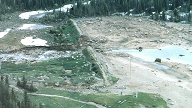 Lawn Lake Dam: Pre-Failure Comprehensive Dam Safety Evaluation and Post Failure Impacts
